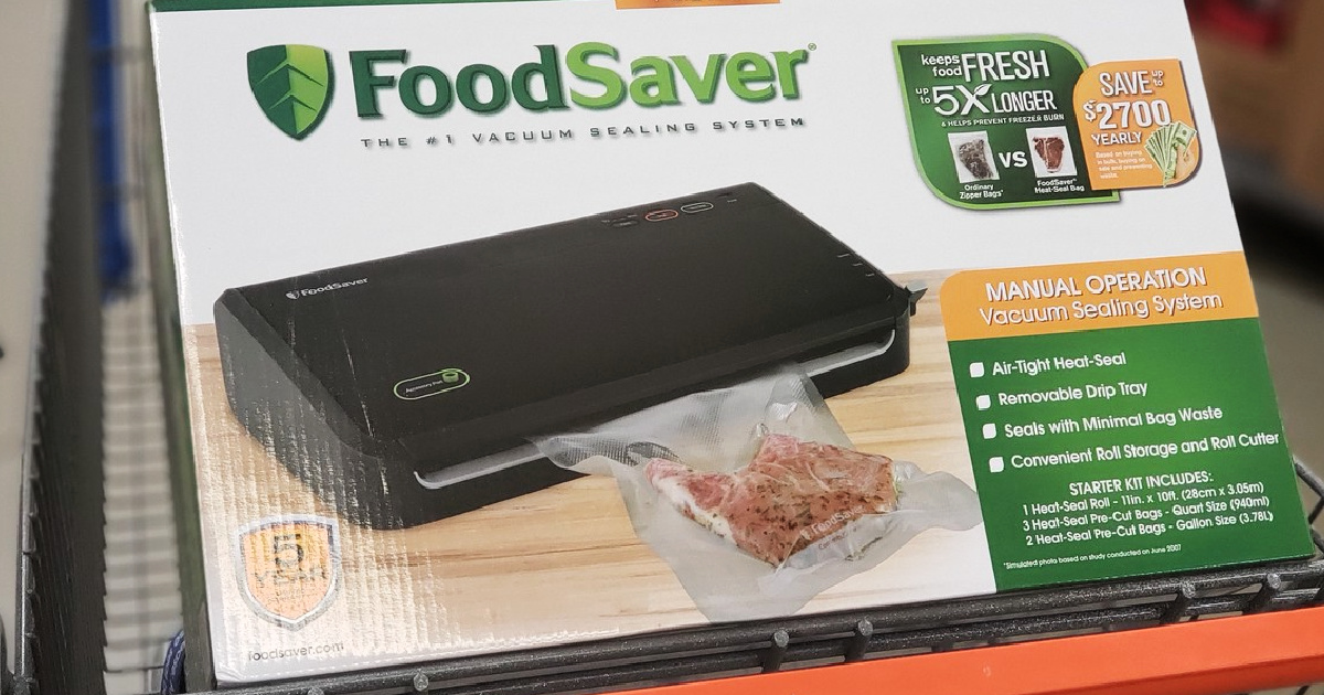food saver machine in box sitting on a store shopping cart