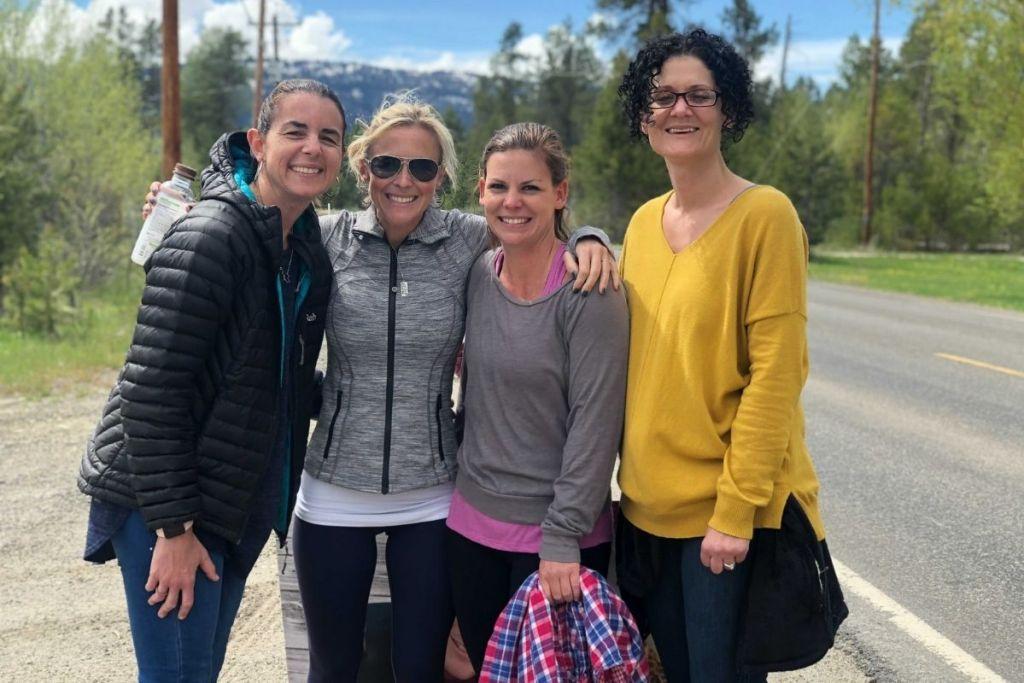 Four women outside smiling