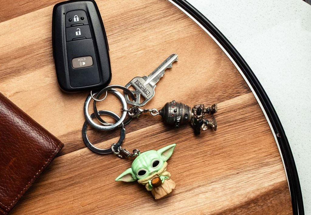 baby yoda and IG11 keychains on wood table