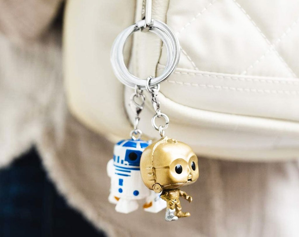 R2D2 and C3PO keychains on a white backpack