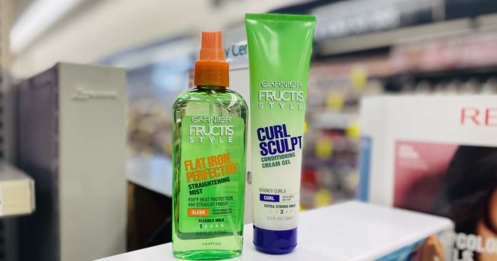 two bottles of green hair products