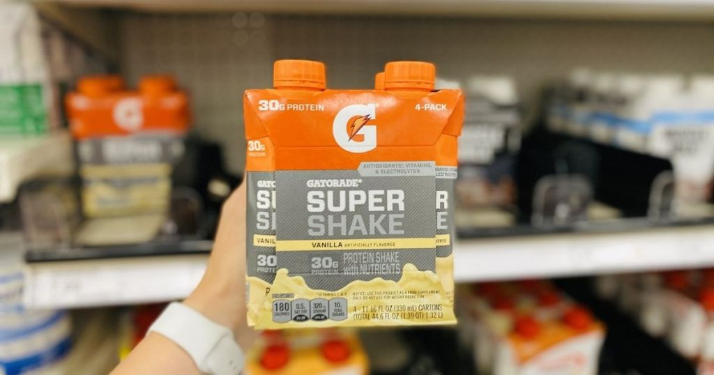 holding a 4-pack of Gatorade Super Shakes