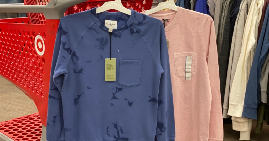 two long sleeve shirts hanging on cart