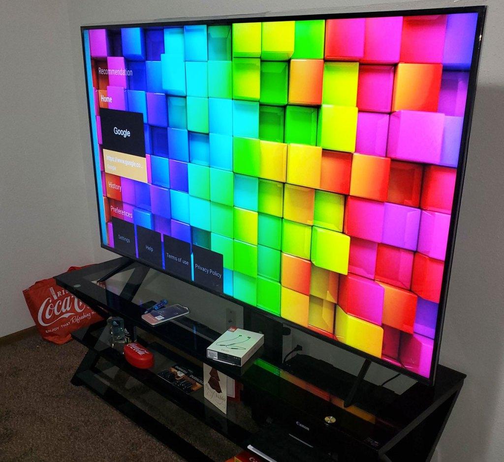 tv displayed rainbow tiled home screen