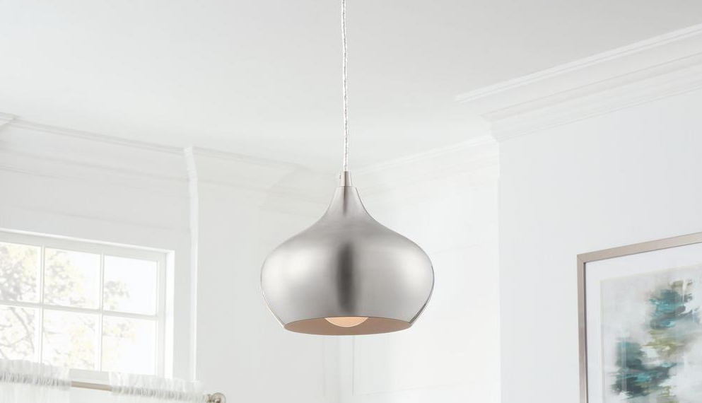 silver pendant light hanging from the ceiling