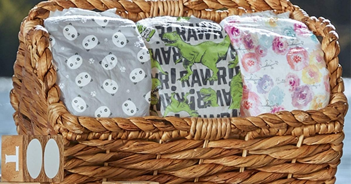 honest company diapers in a wicker basket