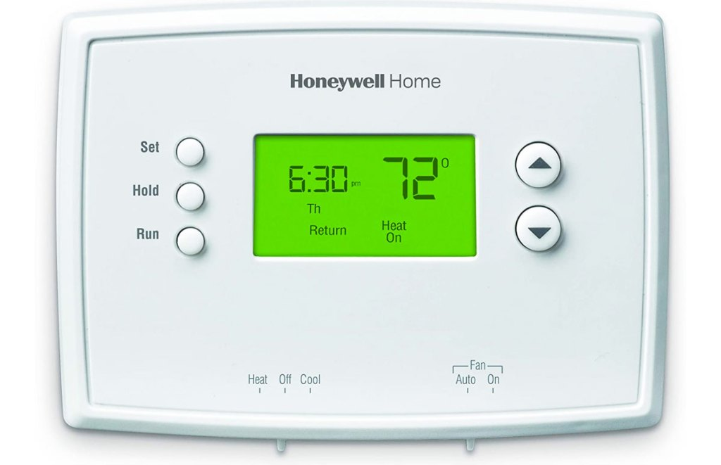 white thermostat with green display