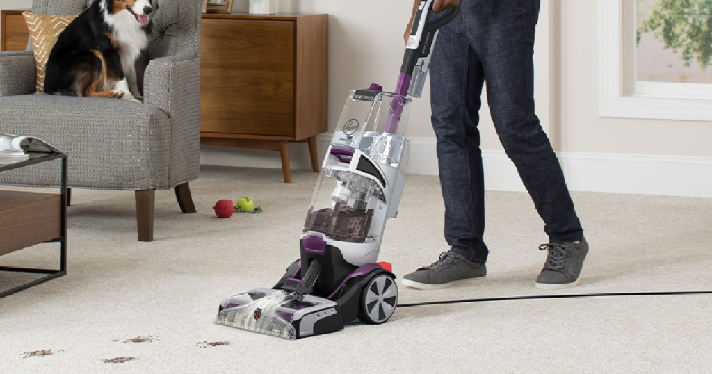 man cleaning carpet with dirt spots with the hoover smartwash