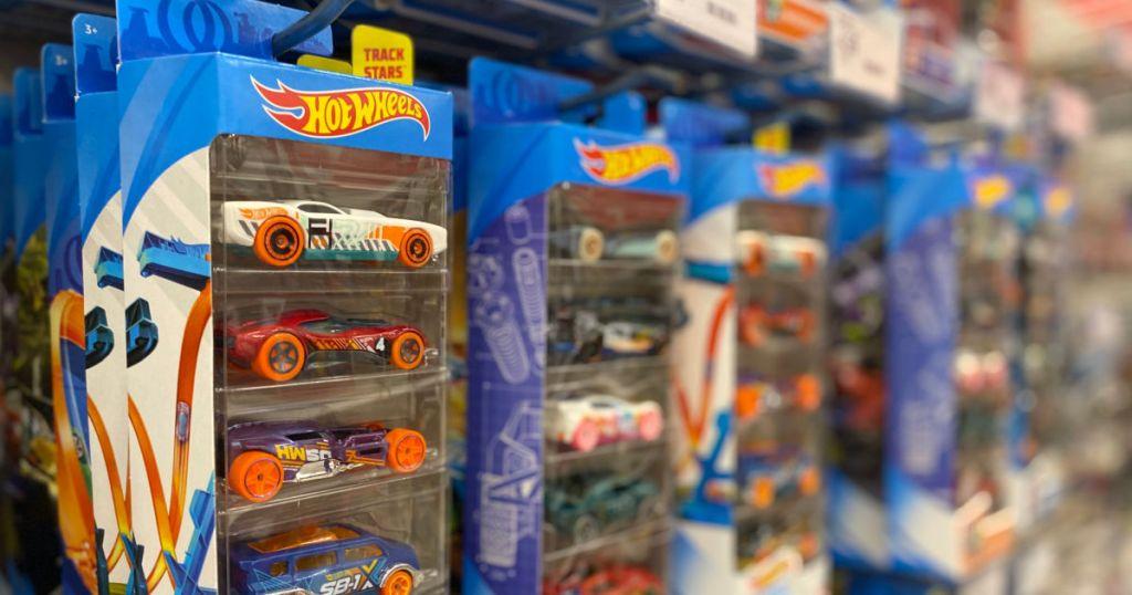 three packs of hot wheels on shelf