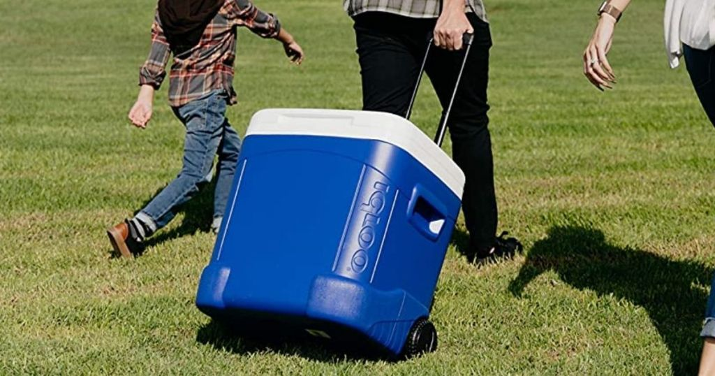 man pulling Igloo Wheeled Cooler outside
