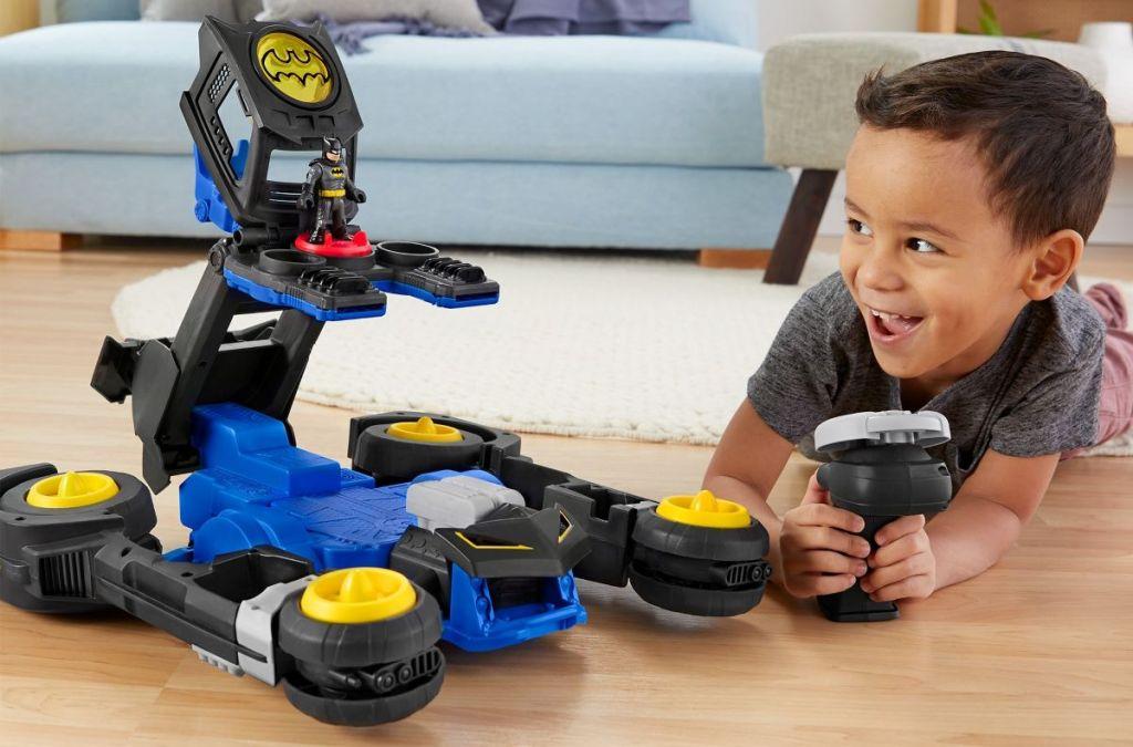 boy playing with a Batman set