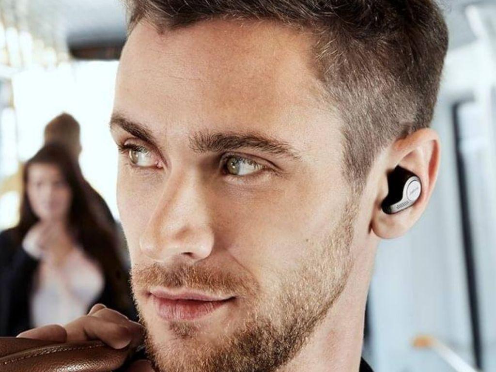 man wearing Jabra Elite Certified Refurbished 65t True Wireless Earbuds