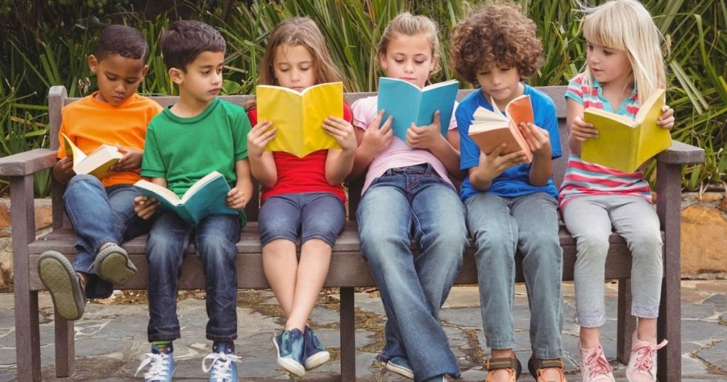 kids on a bench reading books