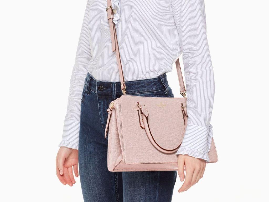 woman carrying pink kate spade bag