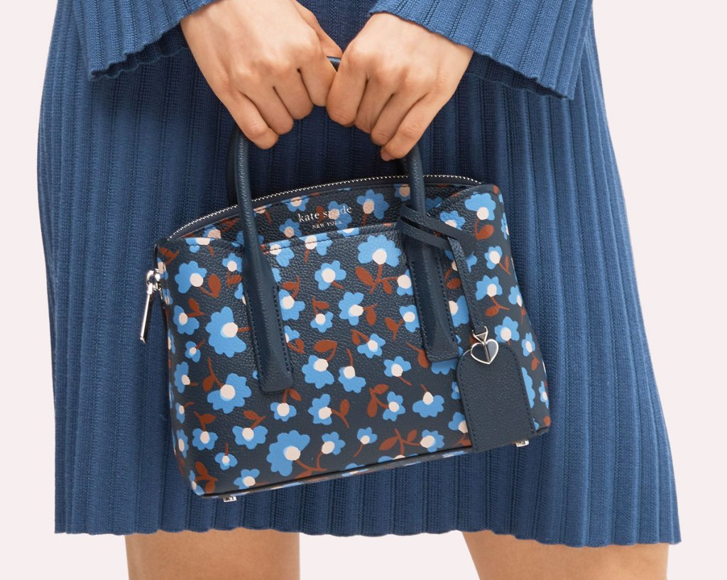 woman in blue dress with blue floral print purse