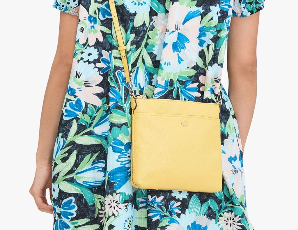 woman in floral dress with yellow crossbody bag