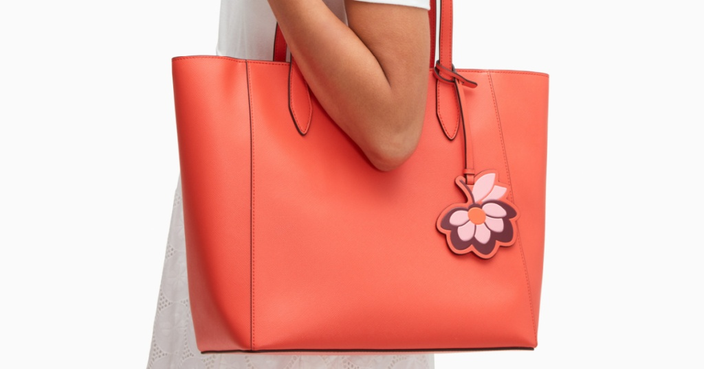 Woman holding a spring style tote bag