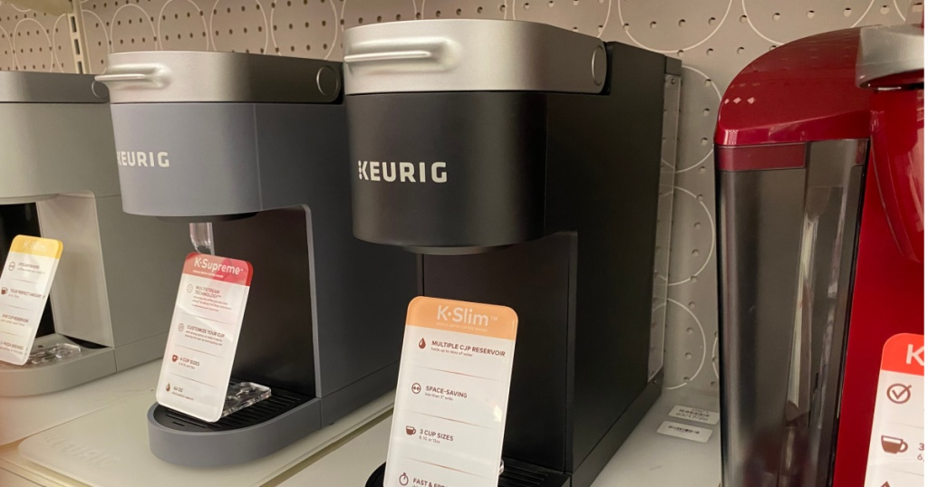 black silver and red coffee maker on shelf