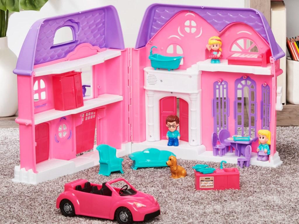 pink and purple folding dollhouse