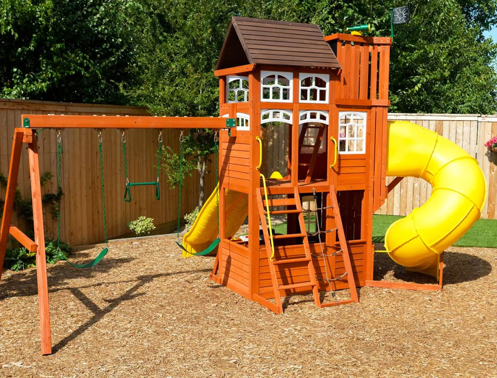 wooden backyard playset with swings and lookout tower
