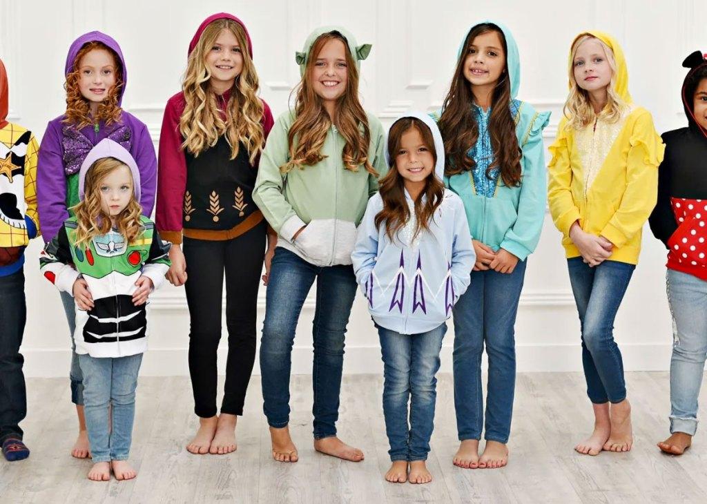 group of girls wearing disney character hoodies