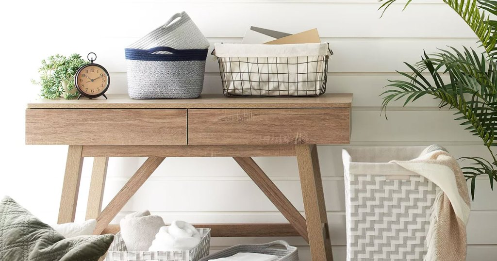 baskets on top of wood console table