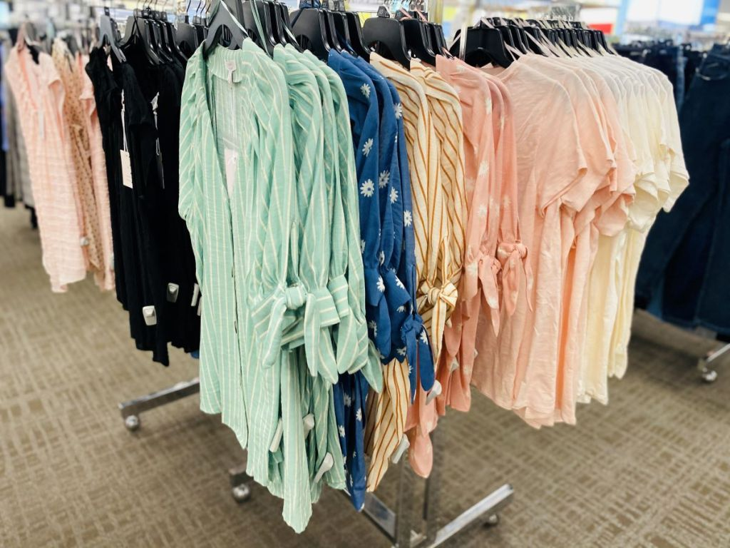 women's tops on hangers at the store