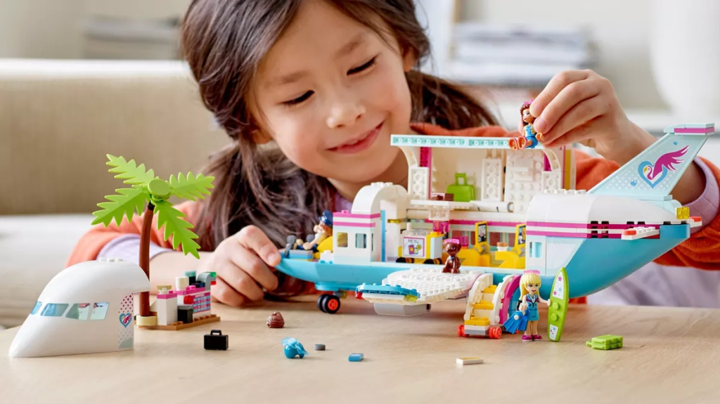 girl playing with a LEGO set