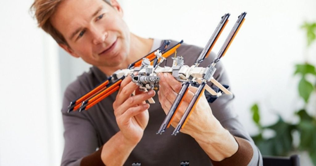 man holding a LEGO Space Station set