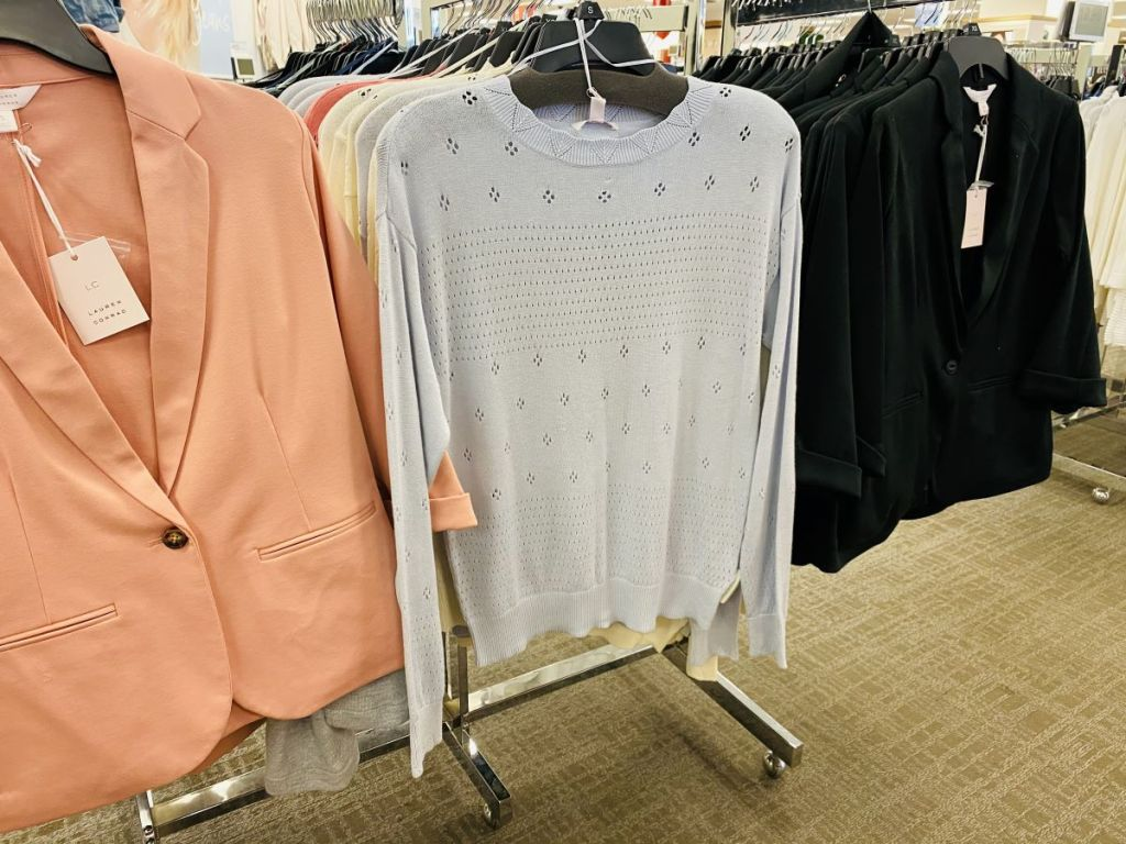 women's sweaters and jackets on hangers