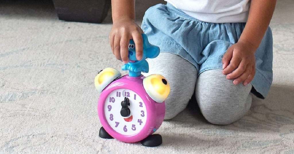 kid pressing down on blues clue on clock