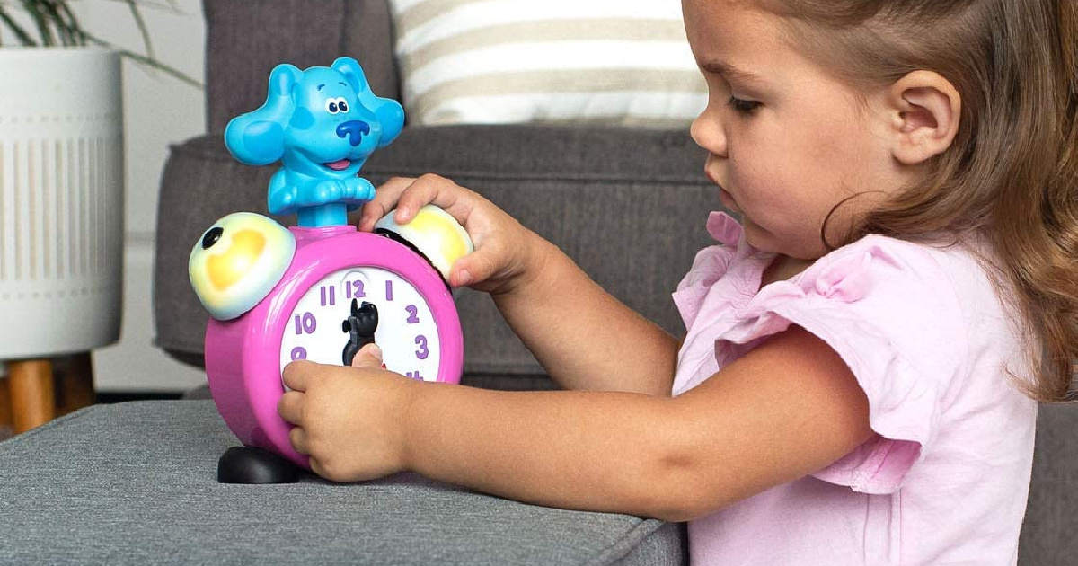 girl playing with LeapFrog Blue's Clue and You! Tickety Tock