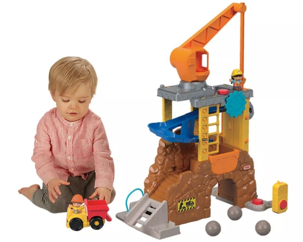 boy playing with Little People Construction