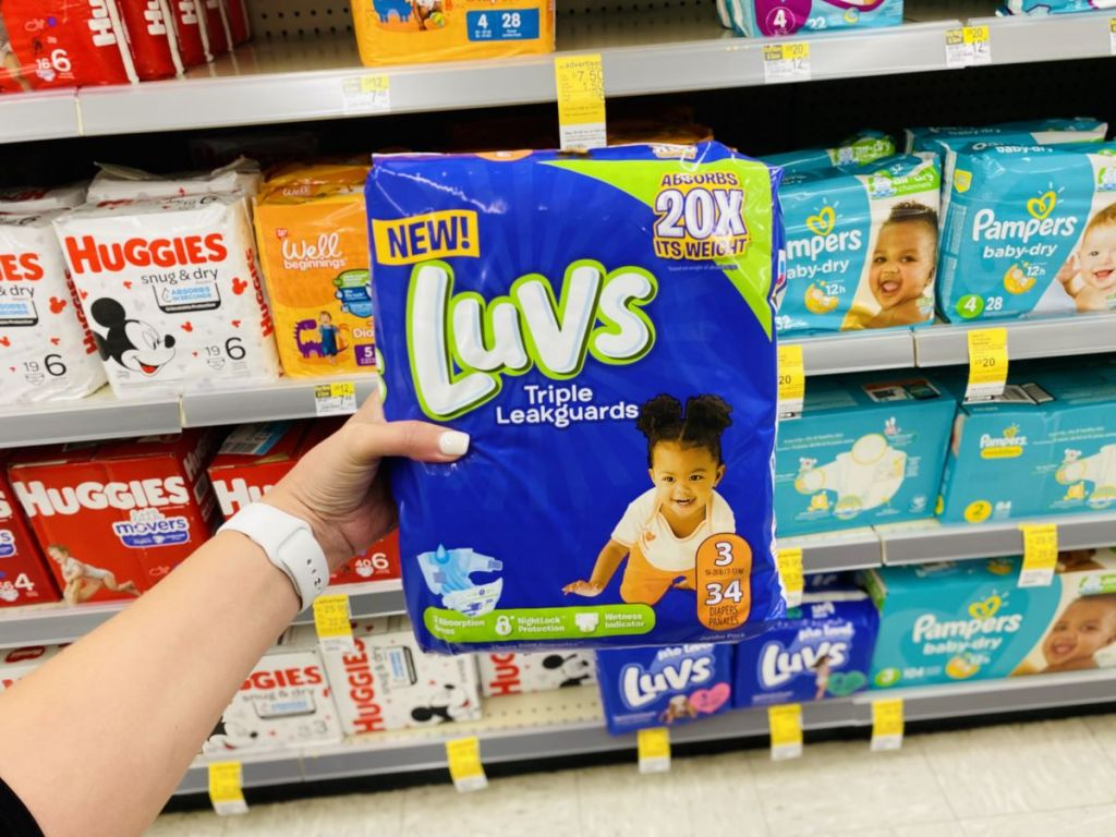 hand holding package of Luvs diapers