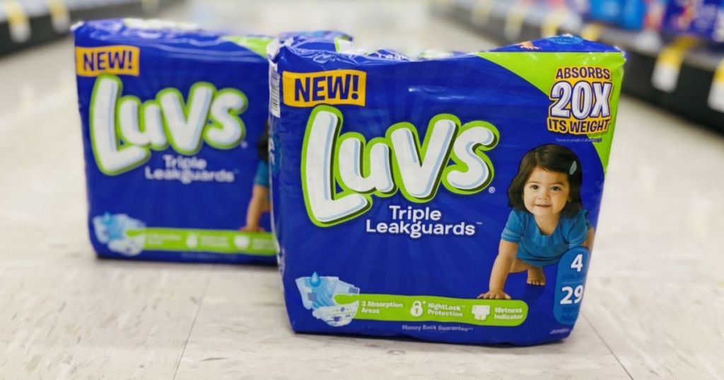 two packages of Luvs diapers