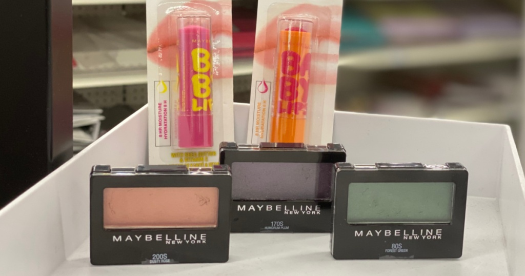 eyeshadow and lip gloss on shelf