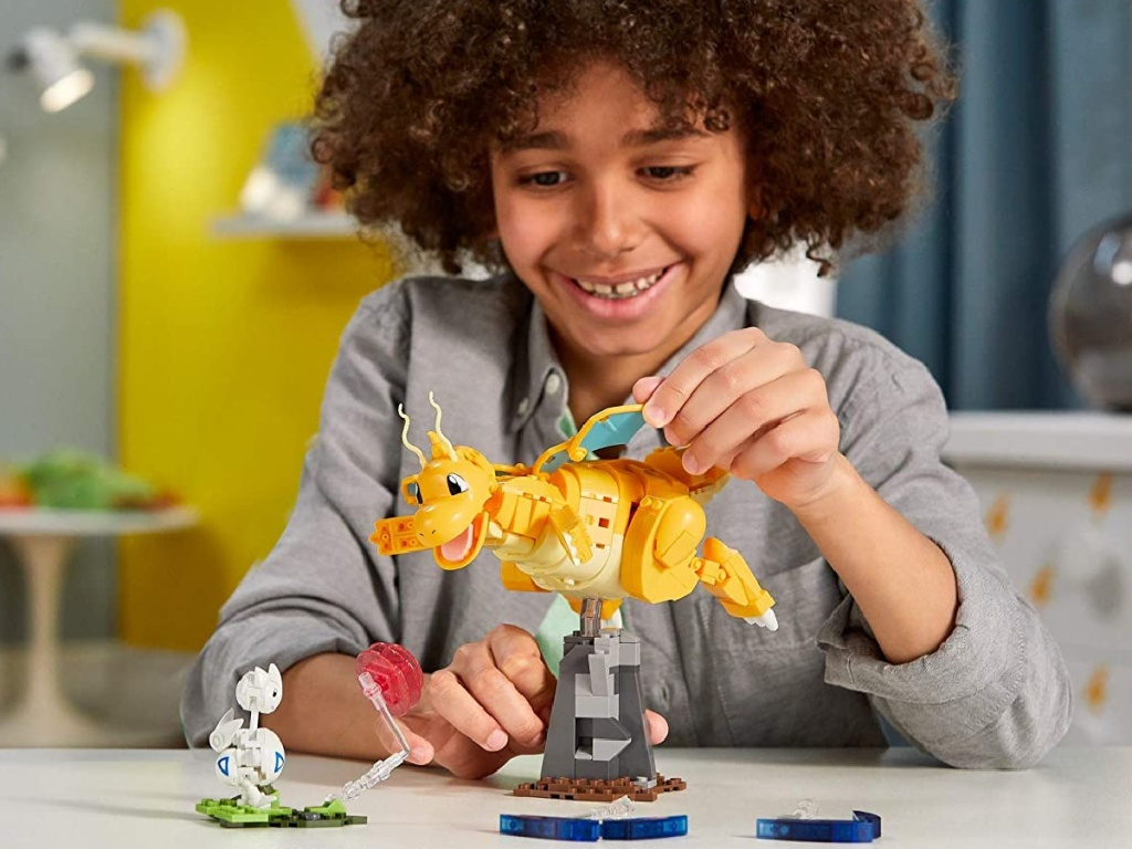 kid playing with Mega Construx Pokemon Dragonite vs. Togetic Challenge Building Set in room