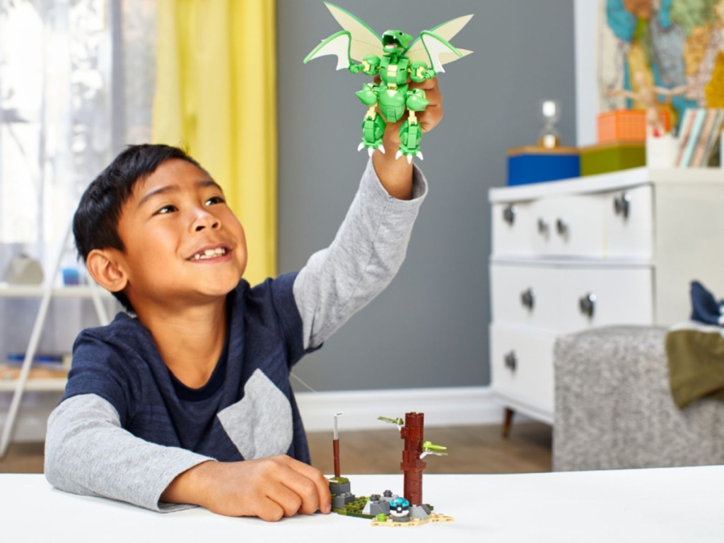 boy playing with Mega Construx Pokemon Super-Sized Scyther in room