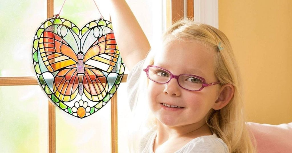 girl holding Melissa & Doug Butterfly Stained Glass Kit