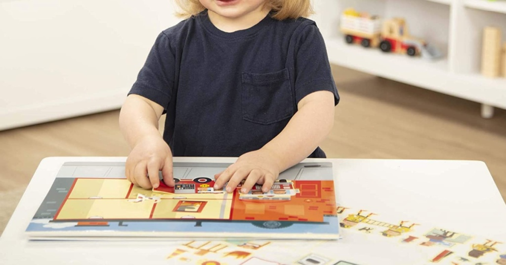small child playing with. melissa and doug sticker set