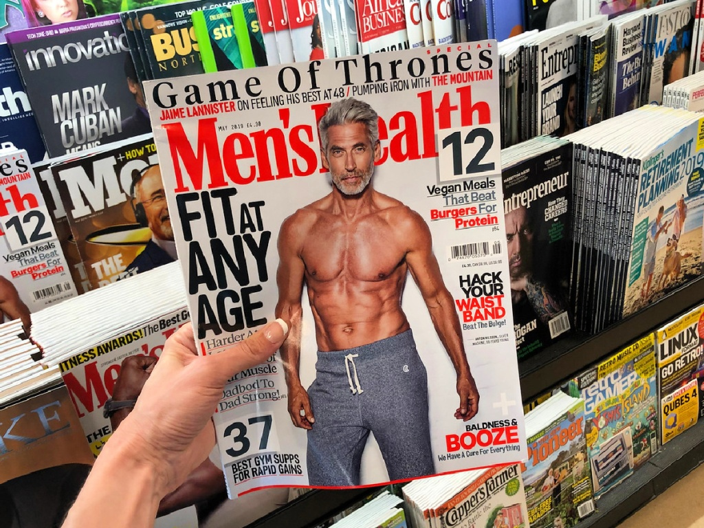 Men's Health magazine in hand