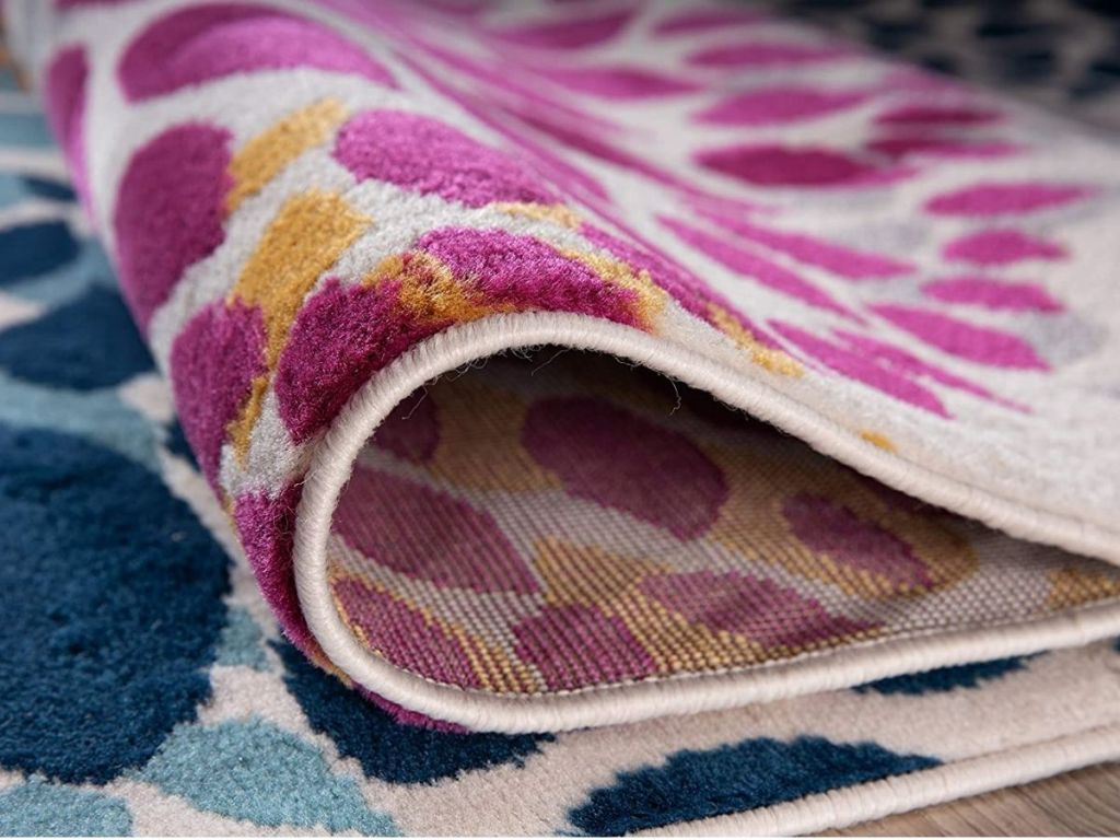 colorful floral rug folded over