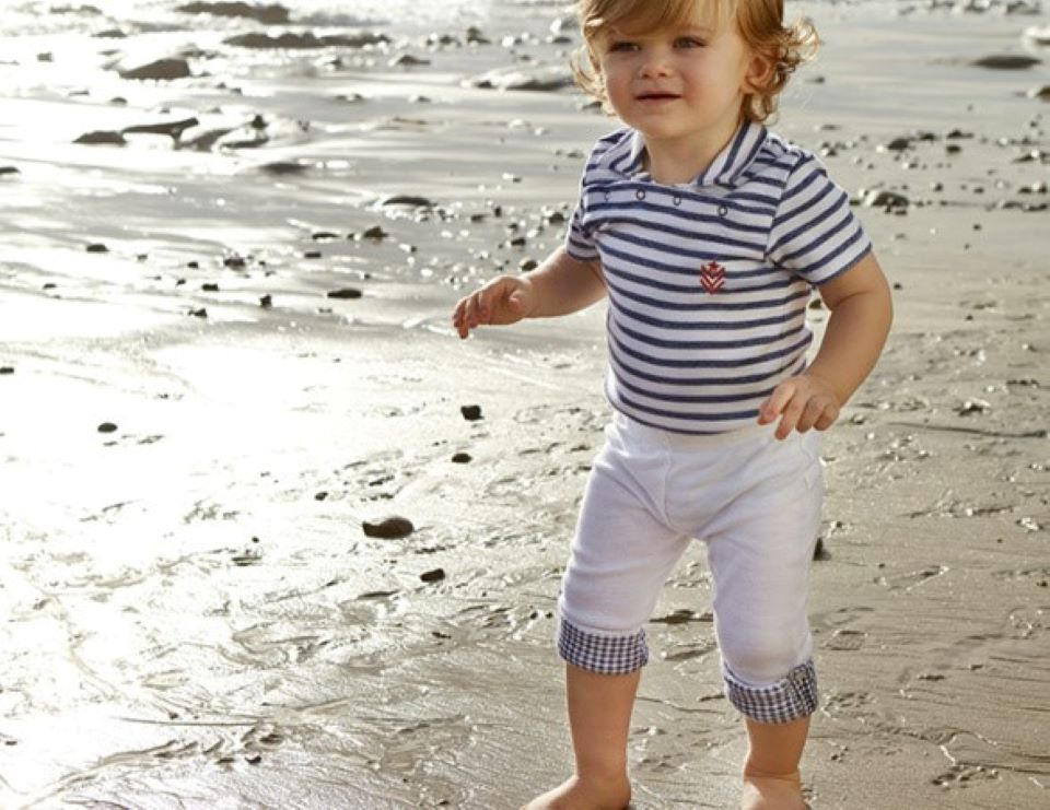 baby standing on the beach