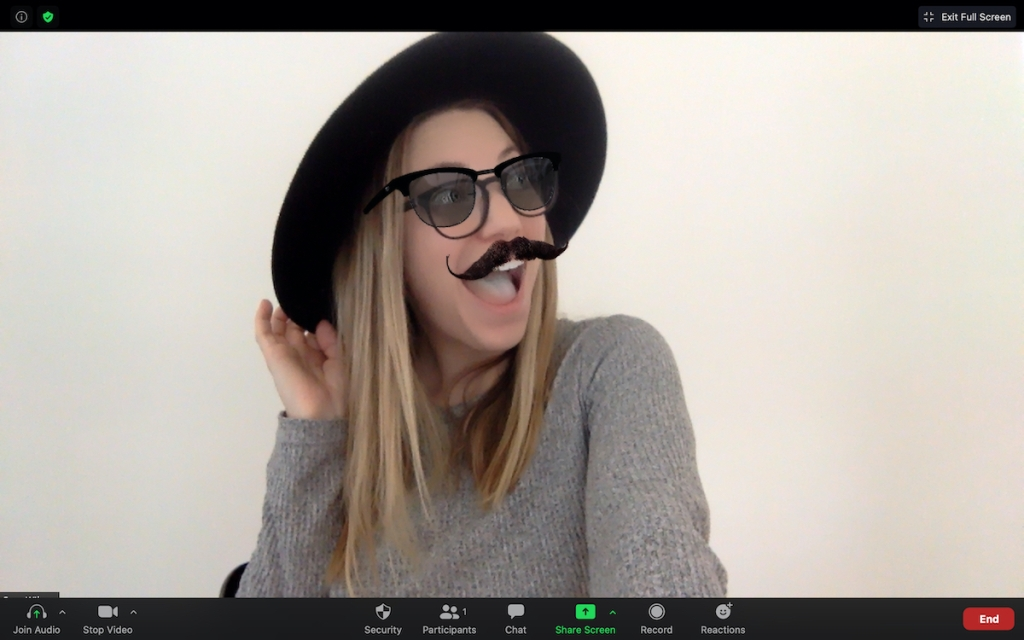 woman posing with black hat and virtual glasses and mustache