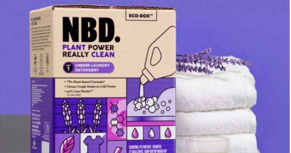 box of laundry detergent by stack of towels