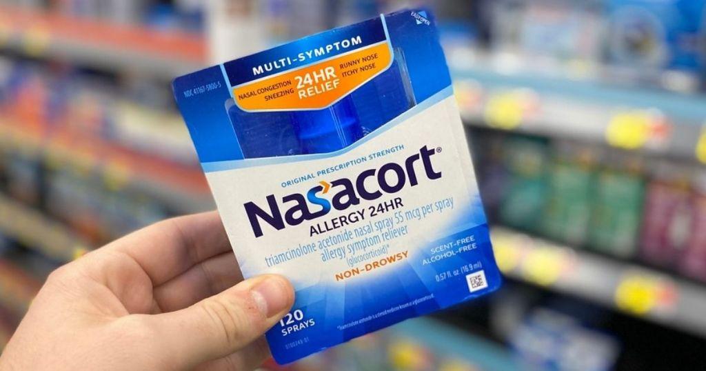 hand holding Nasacort Allergy 24HR in store
