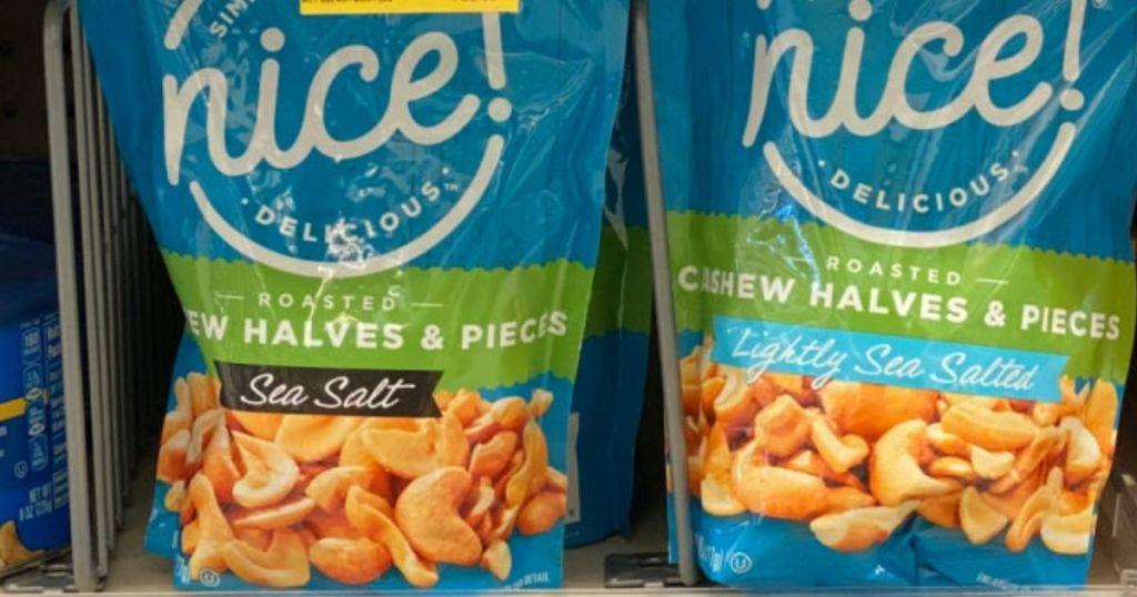 two bags of nice cashews on a shelf