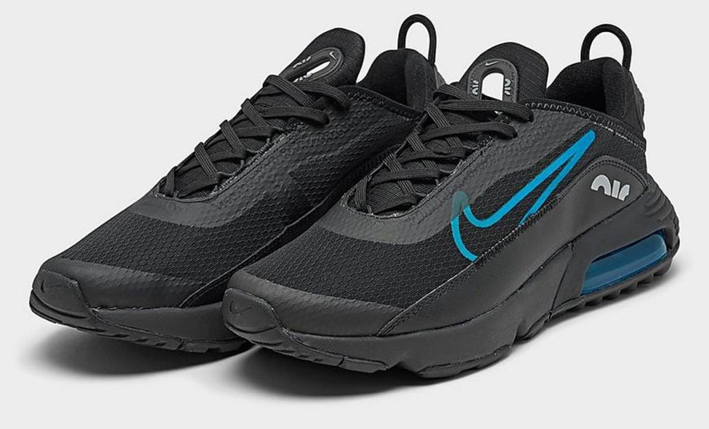 black pair of nike boys shoes