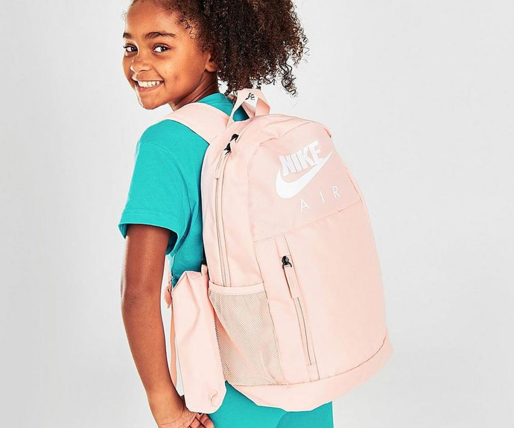 girl wearing a light pink backpack