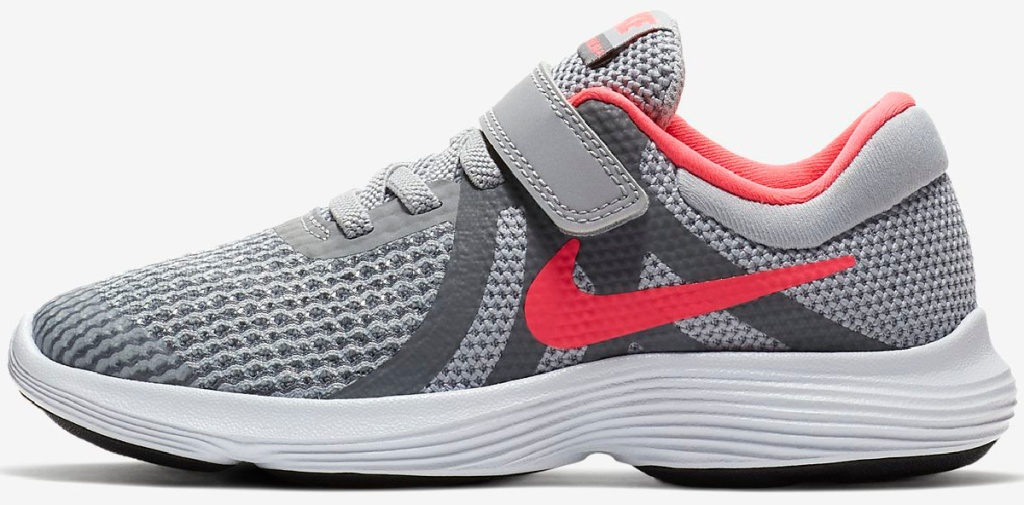 grey, pink, and white pair of nike kids sneakers